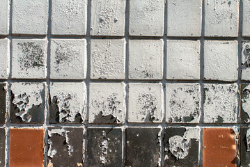 chipped paint on the wall are covered with ceramic tiles texture