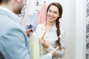 Spouses at boutique changing cubicle