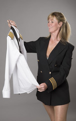 Woman officer getting dressed into uniform