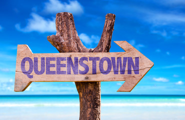 Queenstown wooden sign with lake background