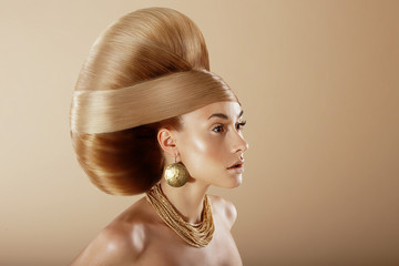 Styling. Profile of Glamorous Woman with Golden Hairdo