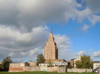 Cityscape with scyscraper and clouds