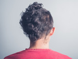 Rear view of man with funny haircut