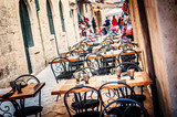 Restaurant terrace in old town of Dubrovnik in narrow streets - 82560915