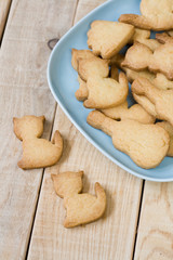 Blue plate with tasty cookies in the form of figurines