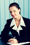 Happy smiling businesswoman writing