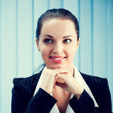 Thinking or dreaming businesswoman