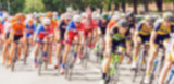 Bikers during bike race on city street, defocussing effect