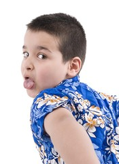 Child with hawaiian shirt sticking his tongue out over white