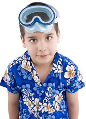 Child wearing hawaiian shirt with swimming goggles on head