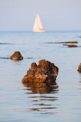 Blurred Boat behind the rocks