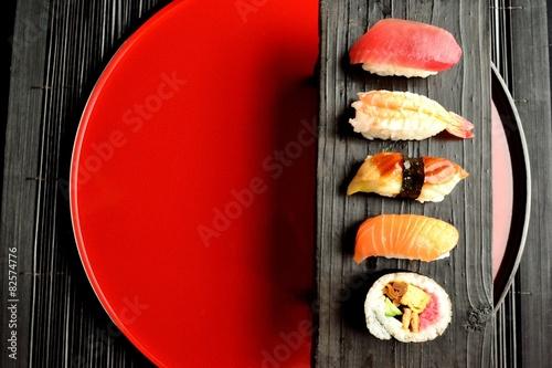 Fototapeta Mixed sushi platter on red tray