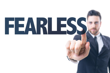 Business man pointing the text: Fearless