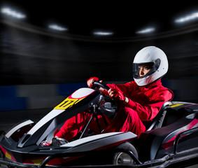 Girl karting racer at stadium