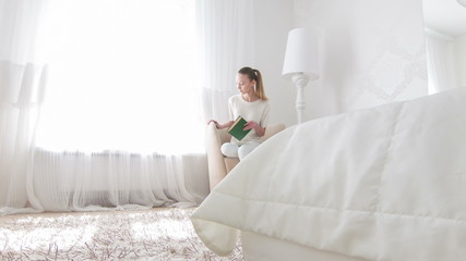 Woman going to read in her bedroom