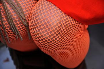 Legs in fishnet stockings