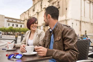 Couple at bar terrace drinking coffee