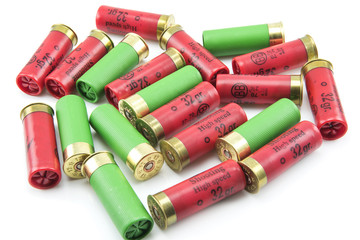 12 gauge shotgun shells isolated on a white background