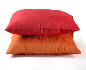 Red and Yellow Pillows on White Background