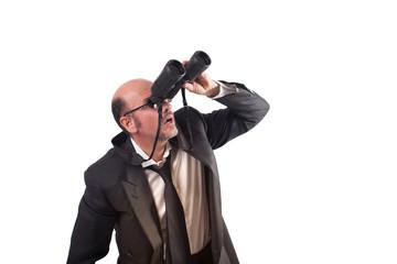 Uomo d'affari con binocolo