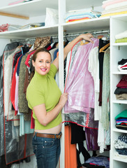Female choosing apparel at store