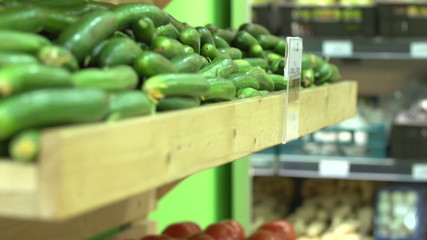Potato to cucumber at the grocery, tilt up