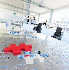 Puzzle in office represents business solutions