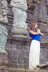 yong woman praying in a monastery