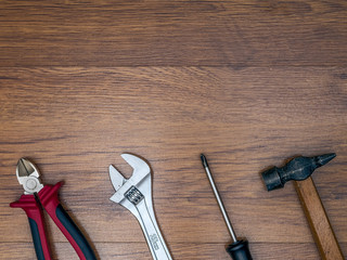 Several tools lying on the wooden floor