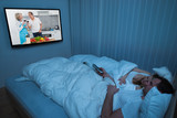 Couple With Blanket Watching Television