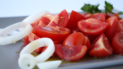 Fresh tomatoes salad with olive oil dressing, dolly shot