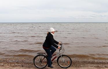 Cyclist at Baltic sea.