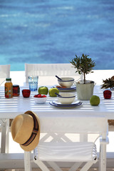 Outdoor dining table with sea backdrop