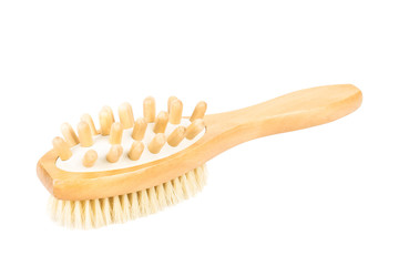 Wooden massager and bath brush on white background