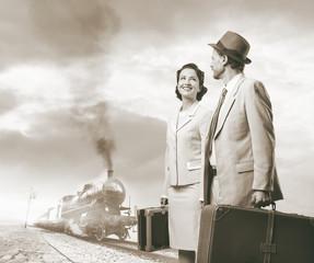 Elegant vintage couple leaving with luggage