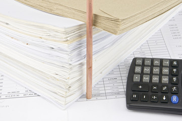 Envelope overload paperwork with vertical pencil calculator