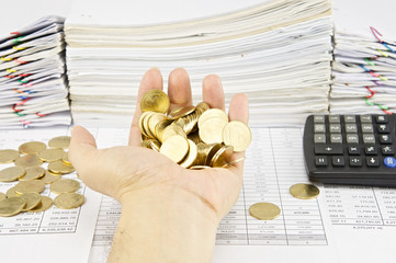 Man holding gold coins over finance account