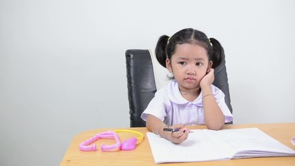 Asian kids Thai girl playing on table.