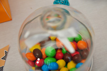 Delicious colorful candy in clear dishes on a holiday baby