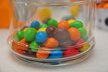 Sweet colorful candy in clear glass decanter