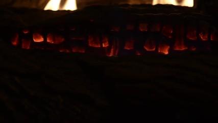 The camera, tilts up on a fireplace