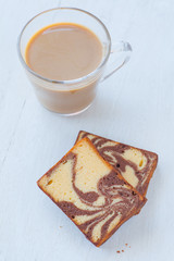 Chocolated and yellow butter marble cake on white background