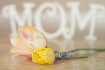 Mother's Day letters with flowers on wood floor black and white