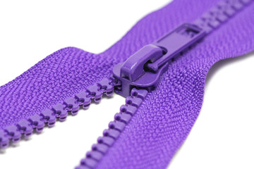 Zips for clothes purple color on a white background