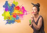 Fototapety Cute girl blowing colorful splash graffiti