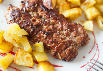 Grilled meat sausages with potatoes