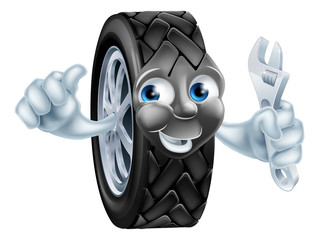 Cartoon tire mascot with wrench