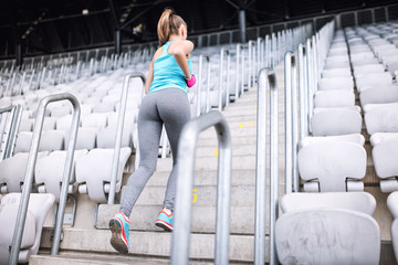 workout at stadium, healthy female doing fitness exercises