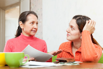mother berates daughter for payments bills or credits
