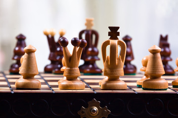 chess pieces on the wood board